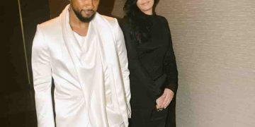 Jenn Goicoechea - a celebrity couple walking hand in hand