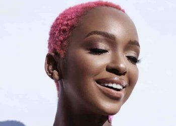 nandi madida - a black woman with short hair dyed pink