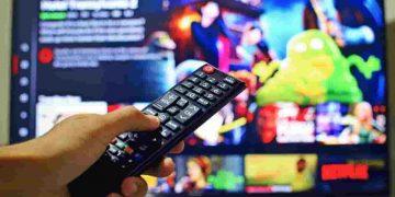netflix showmax amazon prime new movies - hand pressing a remote control